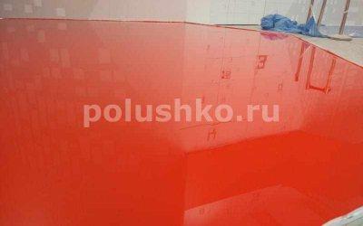Красный эпоксидный наливной пол на выставочном стенде в павильоне ВДНХ